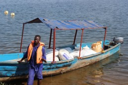 This cage fish farmer plans to harvest fish from the fishing cages on Lake Victoria. Credit: Wambi Michael/IPS