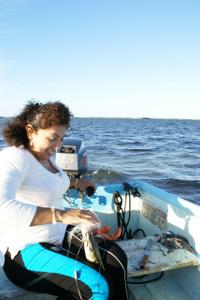 San Felipe Mayor Adlemi Marrufo at work, on her boat.  Credit: Adriana Vargas León /IPS