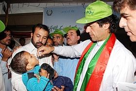 Cricket icon and politician Imran Khan lends a hand with oral polio vaccination. Credit: Ashfaq Yusufzai/IPS