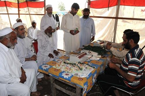 Pilgrims preparing for Haj at a centre in Peshawar.  Credit:  Ashfaq Yusufzai/IPS.