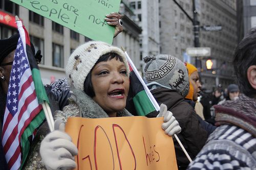A woman holds a sign at Occupy Wall Street. Credit: Timothy Krause/CC BY 2.0