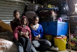 Orphans Moliehi (17), Lefa (9) and Ithabeleng (15) live by themselves in a small shack.  Credit: Kristin Palitza/IPS