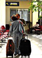 Bolivian migrant in the airport in El Alto, next to La Paz.  Credit: Franz Chávez/IPS