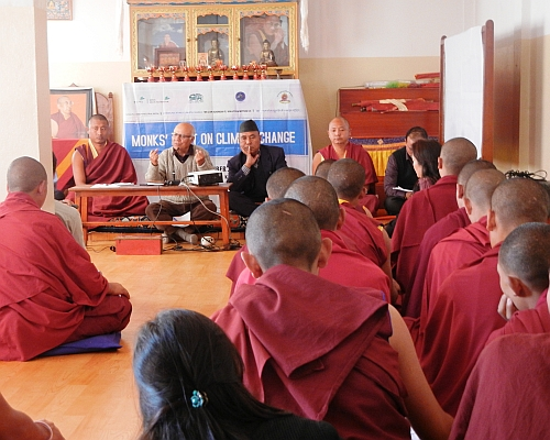 Monks at a prayer session against climate change.  Credit: Sudeshna Sarkar/IPS
