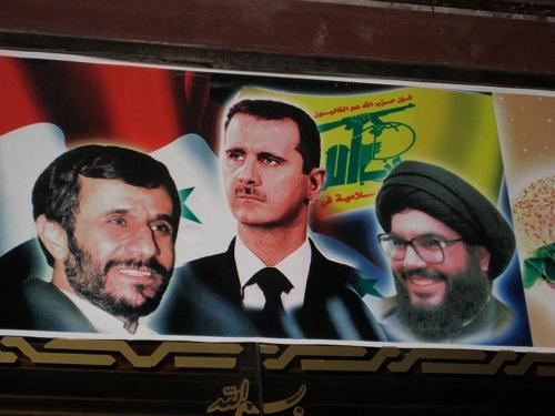 A poster in Damascus, Syria, features Iranian President Mahmoud Ahmedinejad, Syrian President Bashar al-Assad and Hezbollah leader Hassan Nasrallah. Credit: Elizabeth Whitman/IPS