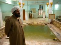 Mandaean spiritual leader Mazin Naif Rahim by an improvised baptism pool in Basra. Credit: Karlos Zurutuza/IPS.