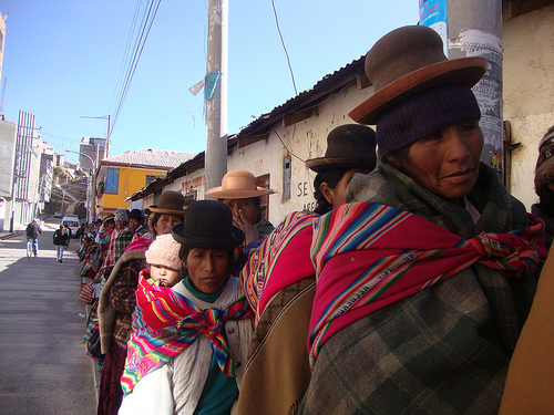 Indigenous women queuing up in a village in Peru's Puno region; they and others require budgets and aid with a gender focus. Credit: Milagros Salazar/IPS
