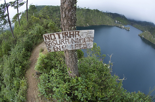 """""""Do Not Throw Garbage or Rocks in the Lake"""", reads this hand-painted sign in Lagunas de Portobello National Park in Chiapas, Mexico.  Credit: Mauricio Ramos/IPS"""