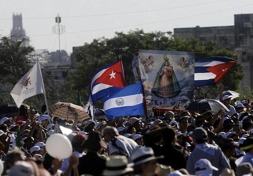 An image of the Virgin Mary next to Cuban flags in the Plaza de la Revolución.  Credit: Jorge Luis Baños/IPS
