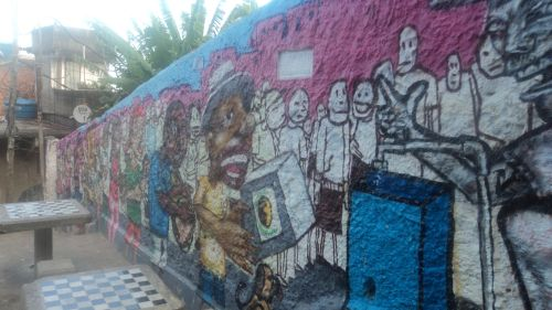 Murals tell the story of life in the Morro de Cantagalo favela.  Credit: Fabiana Frayssinet/IPS