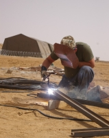 Polish army engineers build a forward operating base near Iriba, in Eastern Chad Credit: David Axe/IPS