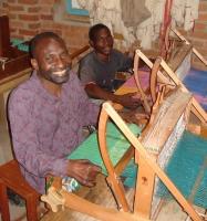 Wheelchair-bound weavers at Neema Crafts in Iringa. Credit:  Sarah McGregor/IPS