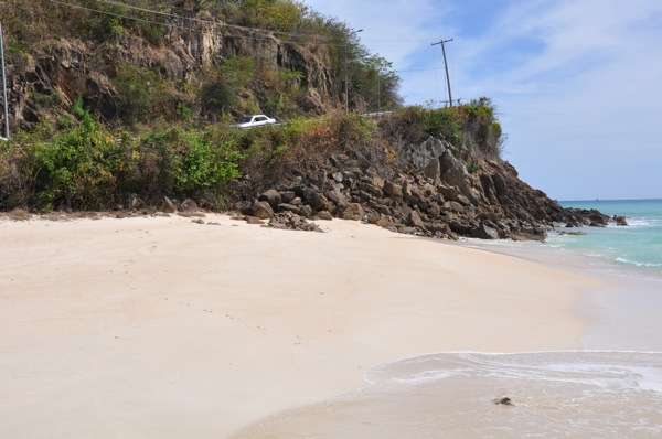 Coastal erosion threatens a roadway on the south coast of Antigua. Credit: Desmond Brown/IPS