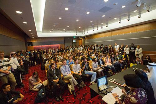 COP 18 president Abdullah bin Hamad Al-Attiyah addresses a roomful of young delegates. Credit: Sallie Shatz – Courtesy of COP 18