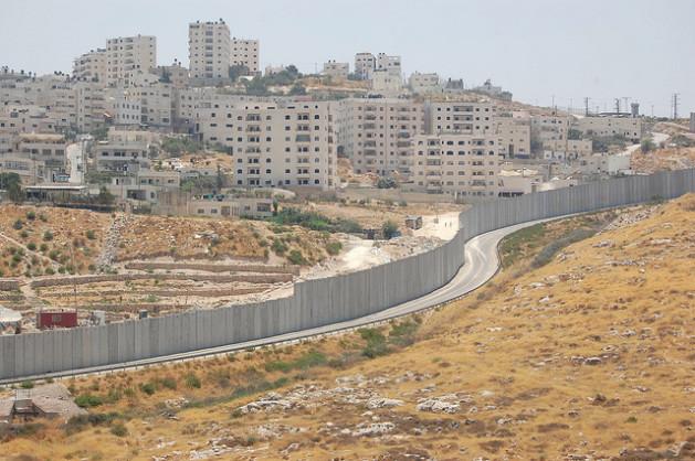 The Shuafat refugee camp can be seen across the separation wall from the Israeli settlement Pisgat Ze'ev. Credit: Jillian Kestler-D'Amours/IPS