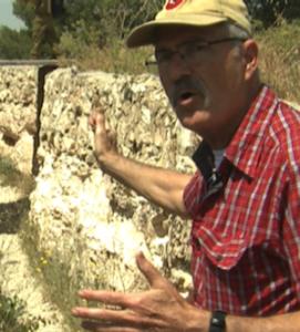 Yaki Chetz, in a Jordanian trench on Ammunition Hill, remembers the 1967 war well. Credit: Pierre Klochendler/IPS