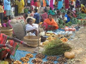 Tribal women converge at the Boipariguda weekly market to sell and buy farm produce. Credit: Manipadma Jena/IPS