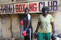 Diana Tulyanabo (l), 20 and her half-sister Helen Baleke (r) at the Rhino Boxing Club in Katanga. Credit: Amy Fallon/IPS