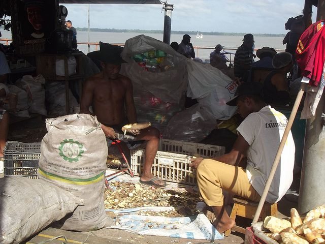 Men peeling cassava at the Ver-o-Peso market in Belém, Brazil. Credit: Diana Cariboni/IPS