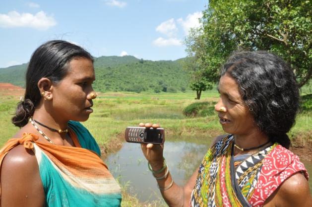 Tribal women from Chattisgarh in India record a message. Credit: Purushottam Thakur/IPS.