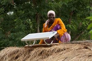 Solar engineer Arafa Mwamba Halfani, from Chekeleni, after installing one of the 20-watt solar panels. Credit: Ben Langdon/VSO