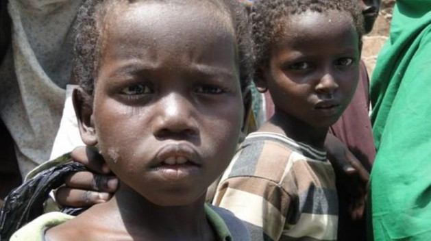 Children from families displaced by the drought line up to receive food at a feeding centre in Mogadishu. Credit: Abdurrahman Warsameh/IPS