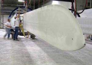 LM Glasfiber workers hoist a wind turbine blade in Grand [...] <a class=