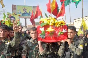 A burial in Serekaniye for fighters fallen in combat against ISIS. Credit: Qadir Agid
