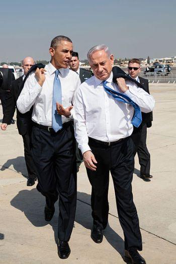 U.S. President Barack Obama talks with Israeli Prime Minister Benjamin Netanyahu as they walk across the tarmac at Ben Gurion International Airport in Tel Aviv, Israel, on Mar. 20, 2013. Credit: White House Photo, Pete Souza