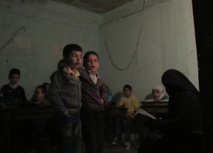 Children signing in underground school in Aleppo, October 2014. Credit: Shelly Kittleson/IPS