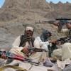 Balochistan Liberation Army commander Baloch Khan checks his rifle alongside his three escorts, somewhere in the Sarlat Mountains on the Afghan-Pakistani border. Credit: Karlos Zurutuza/IPS