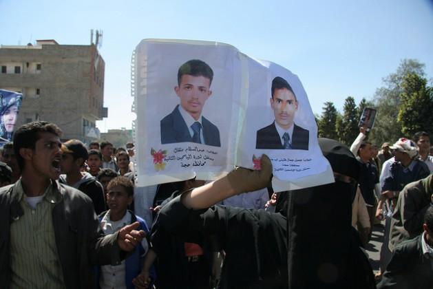 Yemeni protesters in Sanaa carrying pictures of arrested men. Credit: Yazeed Kamaldien/IPS