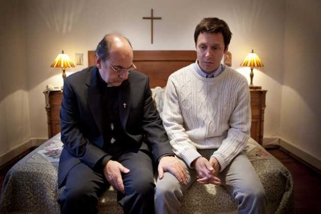 """Actors Luis Gnecco (left) and Benjamín Vicuña in a scene from """"Karadima's Forest"""", a film that portrays pedophile Chilean priest Fernando Karadima, seen here with one of his victims, James Hamilton, his """"favourite"""", who finally dared to speak out. Credit: Courtesy of Constanza Valderrama"""