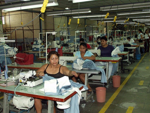 Factory workers make sportswear for a U.S. brand at a maquila plant in the San Bartolo free trade zone in the city of Ilopango in eastern El Salvador. The factory employs 350 workers on each eight-hour shift, 80 percent of them women, who earn minimum wage. Credit: Edgar Romero/IPS