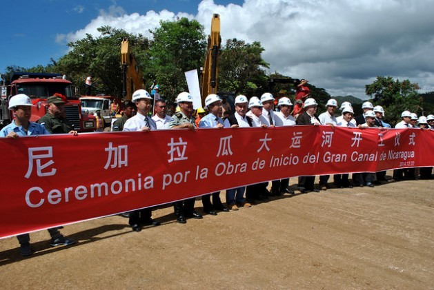 Executives of the Chinese company HKDN and members of the Nicaraguan Grand Interoceanic Canal Commission, behind a large banner on Dec. 22, 2014, in the Pacific coastal town of Brito Rivas, during the ceremony marking the formal start of the gigantic project that will cut clean across the country. Credit: Mario Moncada/IPS