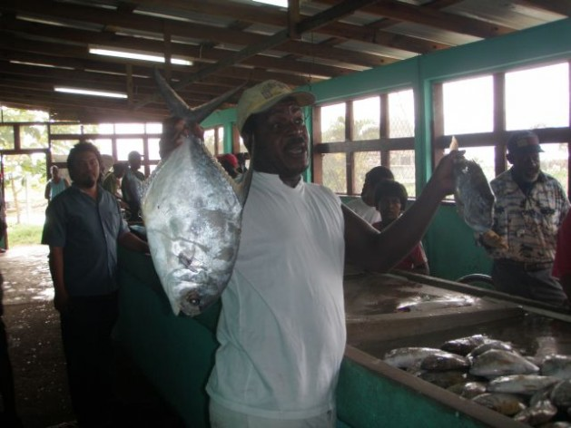 Vendors at the fish market in Belize. Courtesy of the Fisheries Department Belize City, Belize.