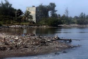 The Quibú River, running through the El Náutico neighbourhood in Havana, is always full of garbage. Credit: Jorge Luis Baños/IPS