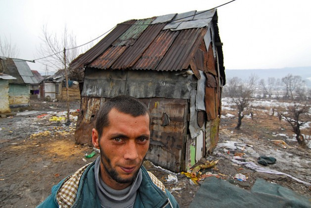 A man lives in the makeshift house behind him, Slovak Republic. Photo: Mano Strauch © The World Bank