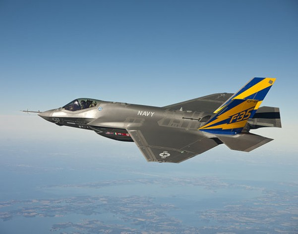 The U.S. Navy variant of the F-35 Joint Strike Fighter, the F-35C, conducts a test flight over the Chesapeake Bay. The F-35 programme includes an unusual arrangement with U.S. allies under which sales of the aircraft will begin as it is being deployed with U.S. forces. Credit: public domain