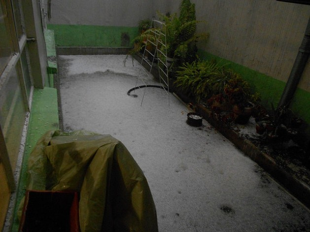 Climate change is causing violent storms, prolonged droughts and temperature extremes. In August 2014, at the height of summer, a hailstorm turned the yard white in this house in the south of Mexico City. Credit: Emilio Godoy/IPS