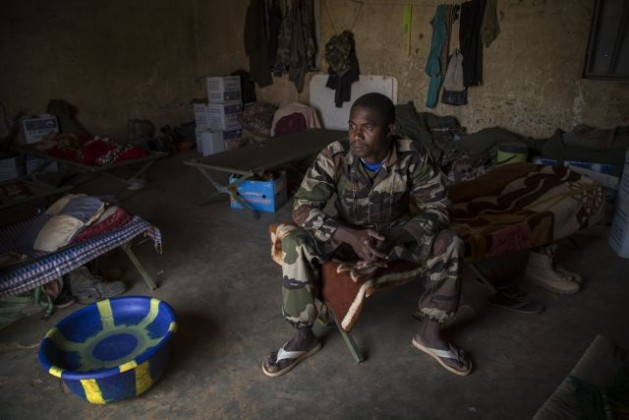 A U.N. peacekeeper from Niger is ready to begin a patrol at the Niger Battalion Base in Menaka, in eastern Mali, Feb. 25, 2015. Credit: UN Photo/Marco Dormino