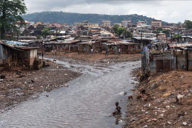 The river that runs through the Kroo Bay slum community in Sierra Leone. Credit: Save the Children