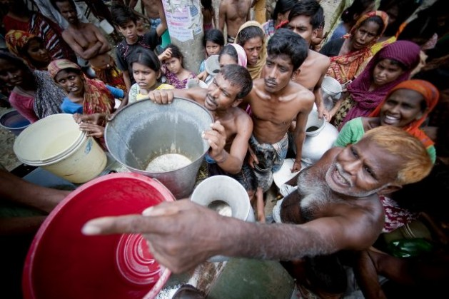 Water is supplied by the military in Old Dhaka, Bangladesh. Credit: UN Photo/Kibae Park