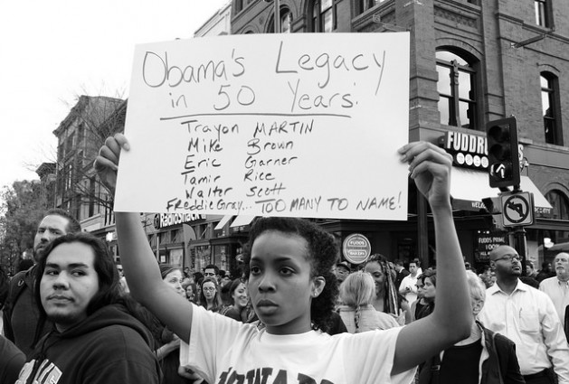 Washington DC, the evening of April 29. 2015. Activists and supporters affiliated with the #DCFerguson movement gathered in Chinatown for a march in solidarity with the Baltimore protests of the cop killing of African-American youth Freddie Gray. The DC event involved over a thousand marchers by the time it wound up in front of the White House. Credit: Stephen Melkisethian/cc by 2.0