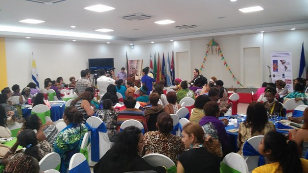 Delegates to the first Summit of Women Leaders of African Descent of the Americas taking part in one of the working groups organised during the three-day gathering held Jun. 26-28 in Managua, Nicaragua. Credit: José Adán Silva/IPS