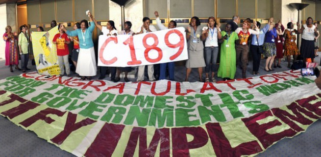 Domestics celebrating the approval of the convention concerning decent work for domestic workers (Convention No. 189) at International Labour Organisation headquarters in Geneva in June 2011. Credit: ILO