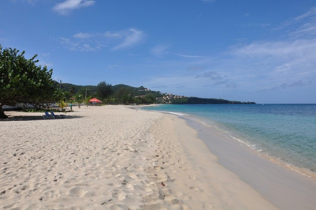 Rising sea levels pose a challenge for tourism-dependent Caribbean economies where the beach is a major attraction. Credit: Desmond Brown/IPS