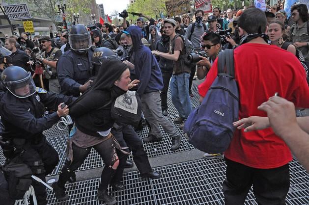 U.S. police arrest May Day protester in Oakland, California. Credit: Judith Scherr/IPS
