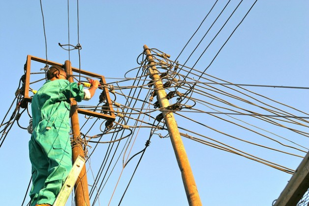An electricity pylon in Somaliland being repaired by Edwin Mireri. Credit: IPS