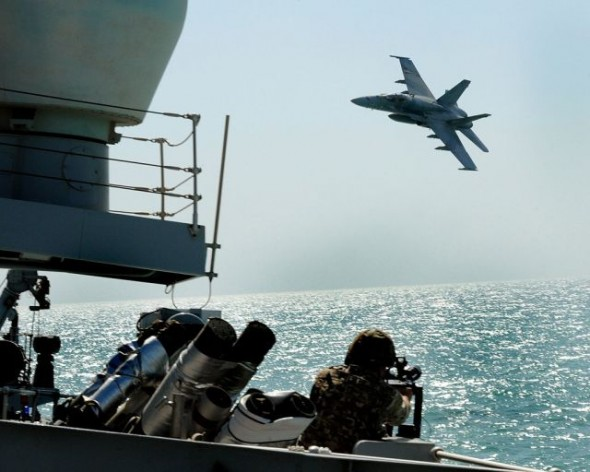 In an exercise, a Kuwaiti F18 Hornet fighter aircraft stages an attack on Royal Navy Type 23 frigate HMS St Albans. Currently, Israel and all six GCC countries are armed with state-of-the art fighter planes, mostly from the United States. Credit: Simmo Simpson/OGL license